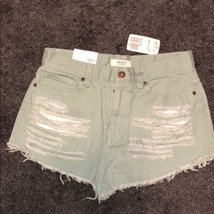 Mint green ripped high wasted shorts
